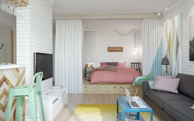 Ascunde-ți patul după o draperie pentru a oferi unei camere utilizare dublă.